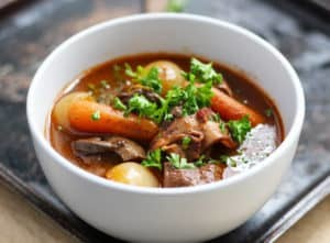 Boeuf Bourguignon | A classic French beef stew made easy. This easy beef stew develops its flavor from many layers, onions, mushrooms, carrots, bacon, beef, red wine, broth, garlic, bay leaf and thyme.