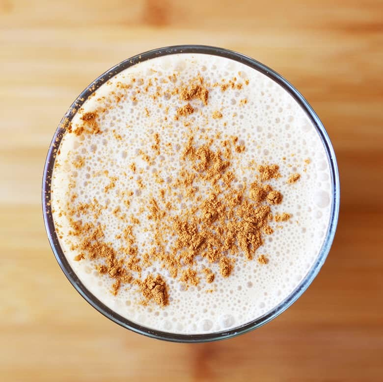 A glass of cashew coffee smoothie