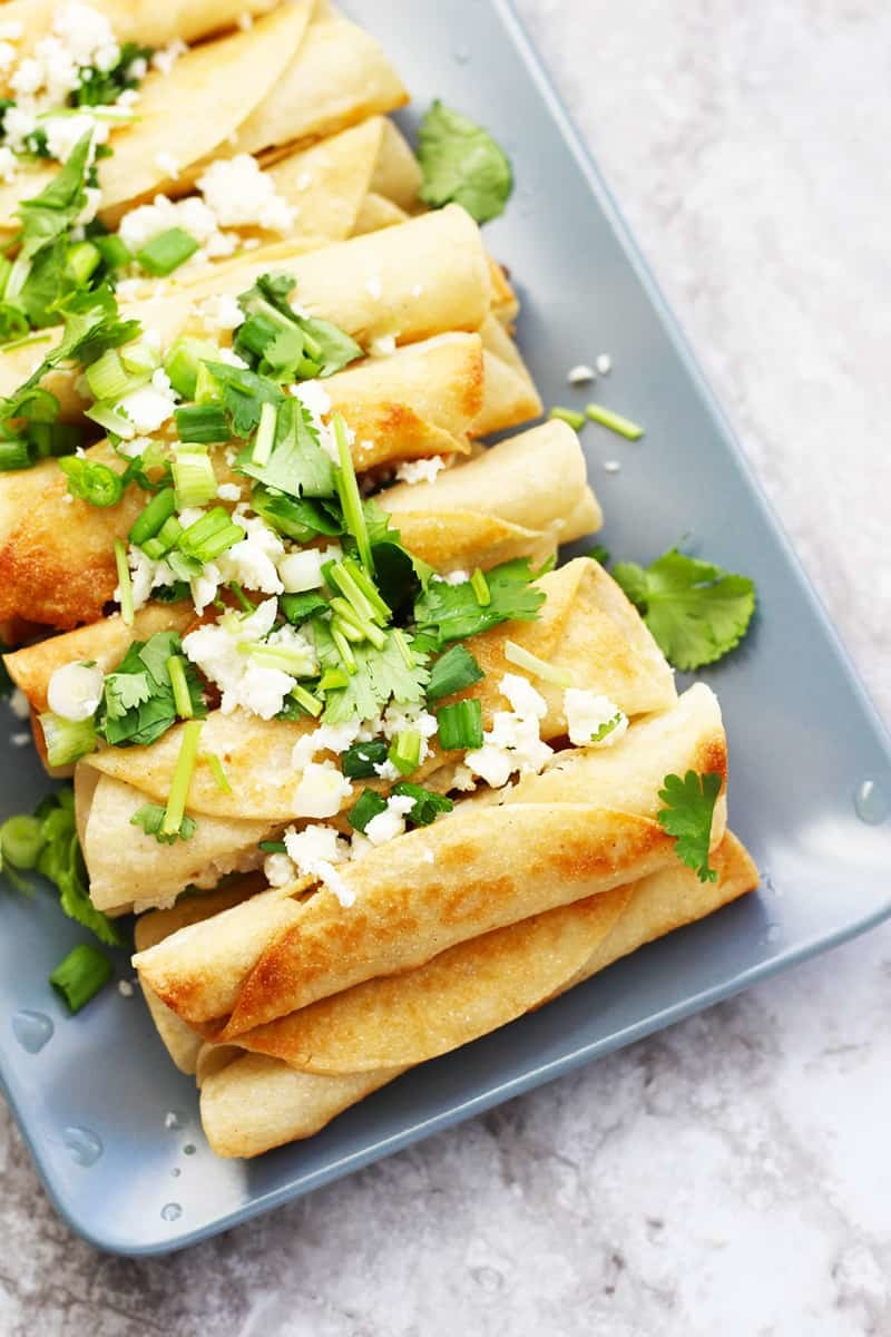A plate of easy, chicken Mexican Flautas.