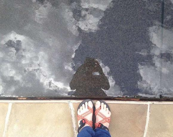Taking a picture of myself in a reflection pool.