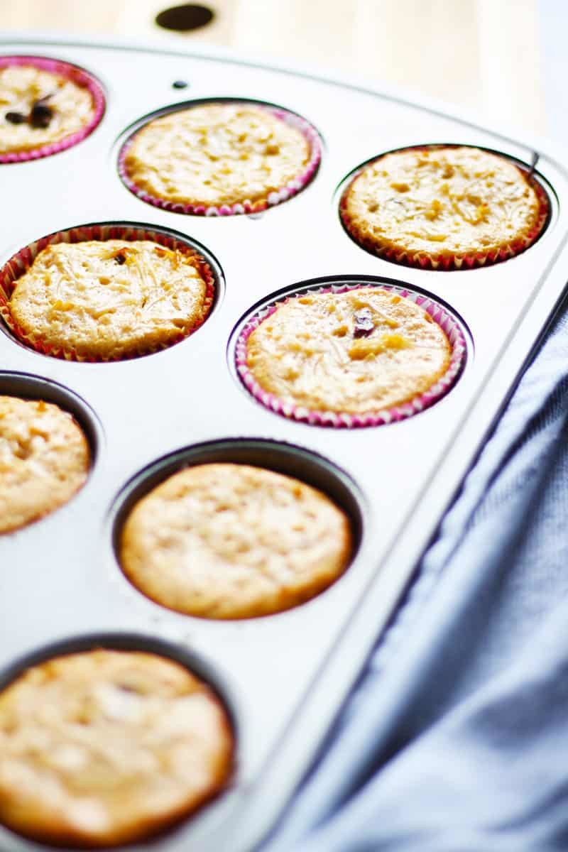 Muffin pan with cooked Kugel muffins.