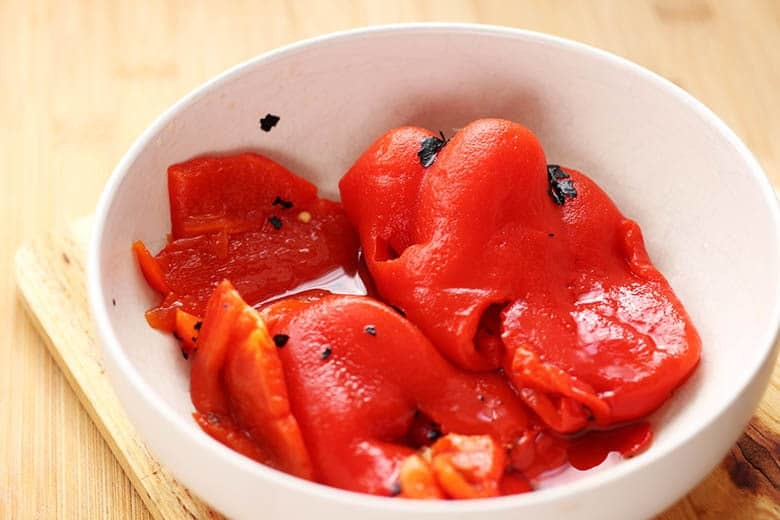 A small bowl of roasted red peppers.