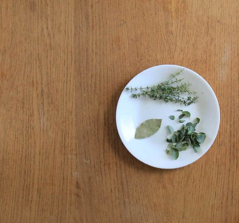 Fresh herbs on a plate.