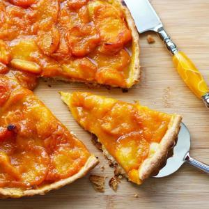 French Apricot Tart Recipe | Tarte Aux Abricots. Making French tarts is really easy to make. The crust comes together nicely in a food processor and the fresh fruit makes for a perfect dessert. This apricot tart recipe will impress your friends and feed a crowd. A perfect dessert for Bastille Day!