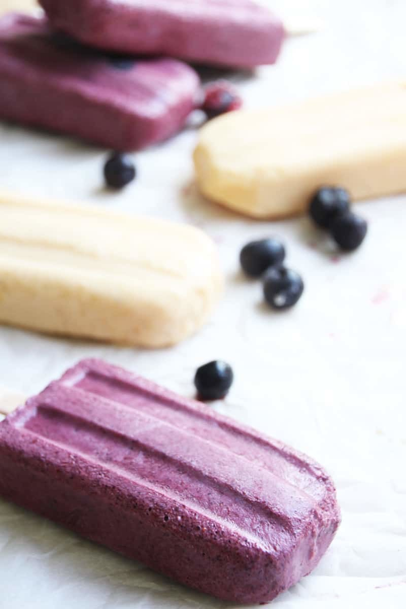 Fruit Froyo Smart Popsicles, a healthy and tasty alternative. Just fruit and healthy yogurt makes this popsicle SMART! Perfect for hot Summer days and the 4th of July! | FusionCraftiness.com