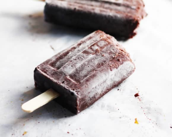 Black Forrest Popsicles with Dark Chocolate Almond Milk. A decadent but healthy Summer Popsicle recipe. Dark chocolate almond milk, extra cocoa and dark cherries make for a rich, chocolatey guilt-free dessert. You are welcome! | FusionCraftiness.com