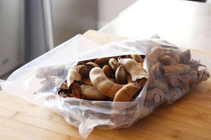 A bag of tamarind pods on the counter.