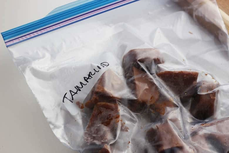 A freezer bag full of tamarind paste ice cubes.