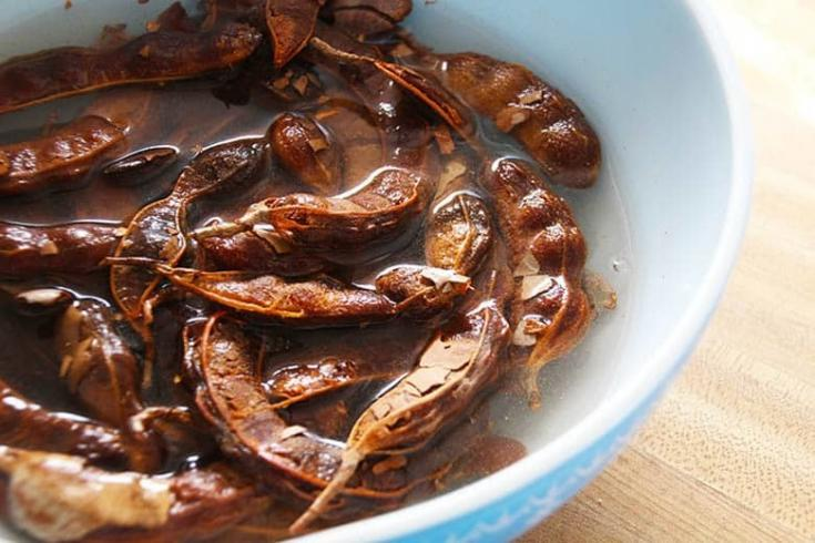 How to make tamarind paste from pods. Make up a batch, pour into ice cube trays and always have some of this condiment at hand. #tamarindpaste #tamarind #tamarindpods #condiment