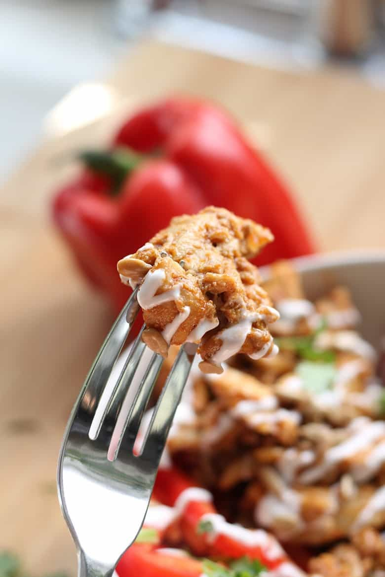 A bite of Chicken Tinga on a fork.