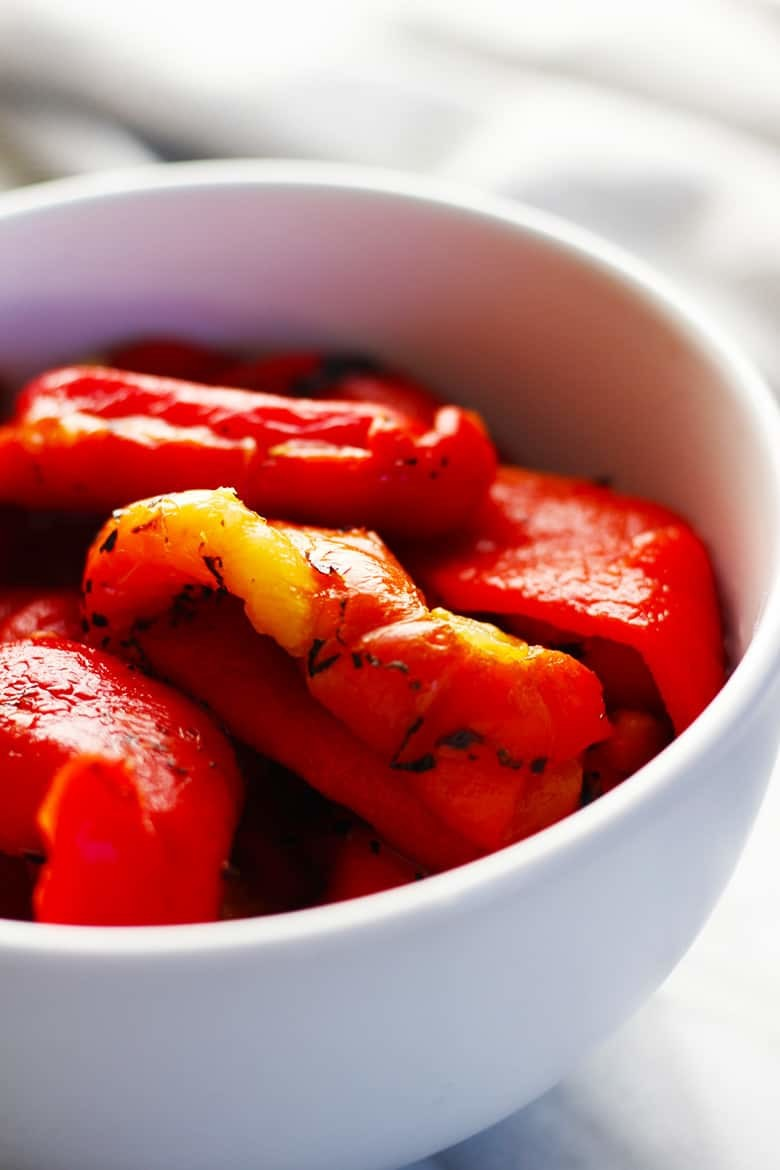 A bowl of roasted red bell peppers.