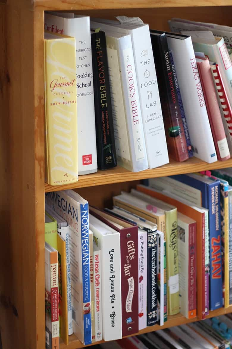 Cookbooks on a bookshelf.