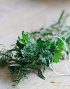 Fresh herbs tied with twine.
