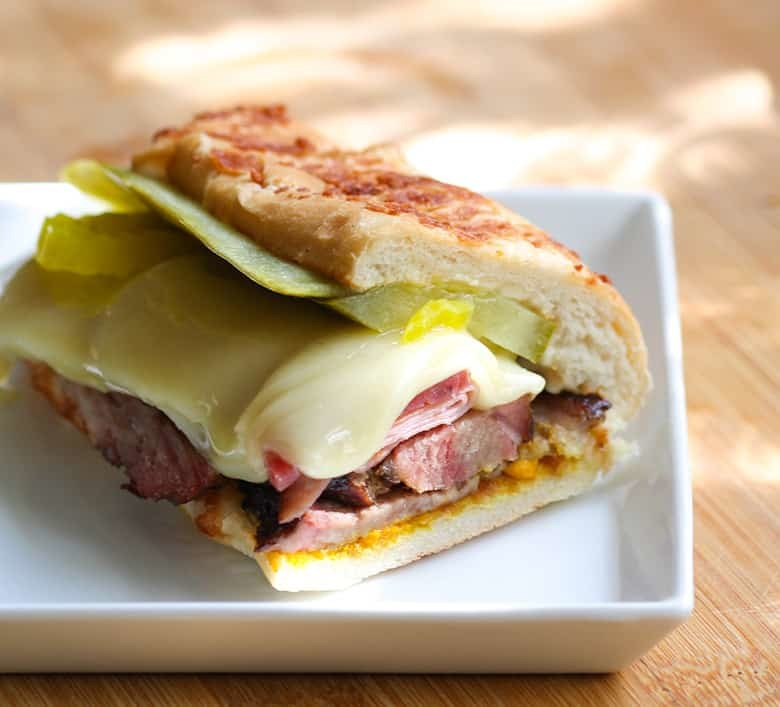 Sandwich Cubano on a white plate.