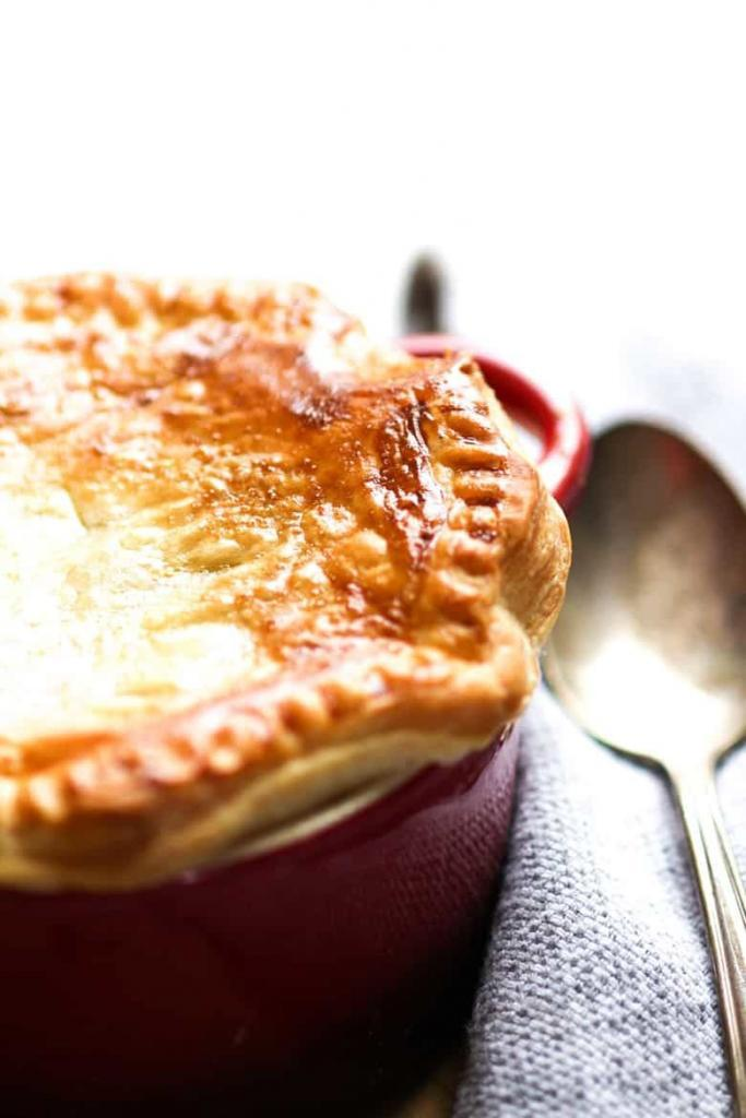 Beef and Guinness Pie in a ramekins with a golden crust of puff pastry.