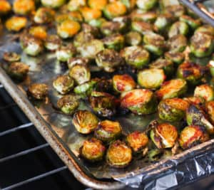 Brussels sprouts halves with marinade brushed on.