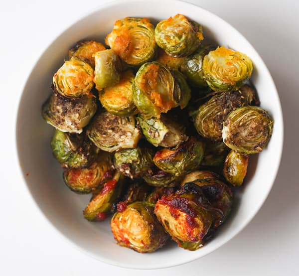 A bowl of roasted Brussels sprouts.