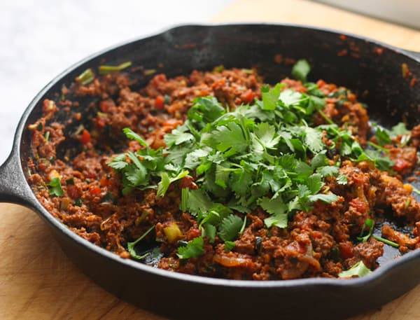 Keema in a cast iron skillet.