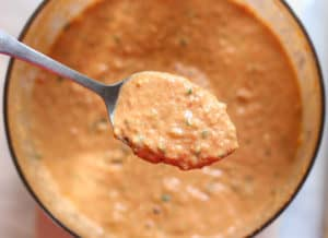 Pureed paprika sauce in a spoon.